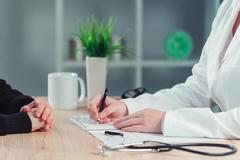 Woman making appointment for medical exam at general practitioner office Stock Photos