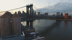 Aerial view of New York City's Manhattan Bridge at sunset in 4k Stock Footage