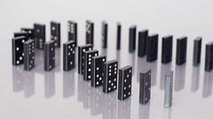 Falling row of dominoes Stock Footage