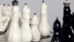 Black and white chessmen on board Stock Footage