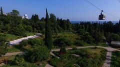 Aerial: Ropeway in Sochi arboretum. Sea view. Stock Footage