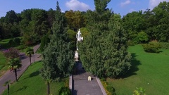 Aerial: Flying next to the fountain statue in Sochi arboretum. Stock Footage