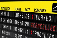 Flight delayed or cancelled display panel in airport Stock Photos