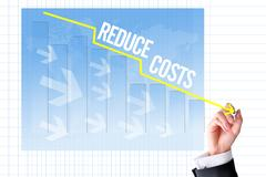 Reduce costs concept with businessman hand draw a graph Stock Photos