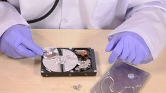 Hard drive and stethoscope Stock Footage