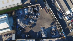 Aerial view of a digger working in a scrapyard. Stock Footage