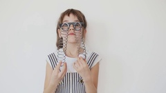 Cheerful Girl make a Faces in Droopy Eye Glasses Stock Footage