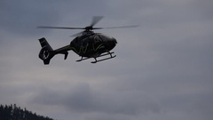 Aircraft, Eurocopter EC135 helicopter landing late afternoon, early winter Stock Footage