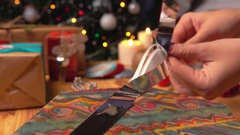 Hands harvested bow for gift wrapping Stock Footage