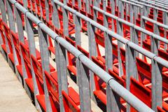 Row of empty red seats in a sports stadium Stock Photos