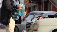 Man driver at the open hood see a steam from boiling cooling water in car Stock Footage