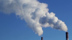 White smoke comes from two tubes against the blue sky, Time Lapse Stock Footage