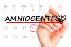 Amniocentesis schedule date on calendar Stock Photos