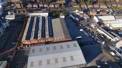 Aerial view of an industrial warehouse in Birmingham, UK. Stock Footage