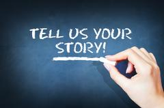 Tell us your story text on blackboard Stock Photos