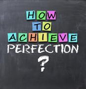 How to achieve perfection question on blackboard with adhesive notes Stock Photos