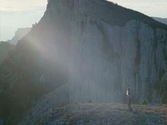 Woman Traveler hiking enjoying mountains landscape on cliff Travel Lifestyle Stock Footage