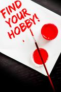 Find your hobby painted in red on a white sheet of paper Stock Photos