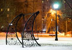 Bench in Moscow evening park background Stock Photos