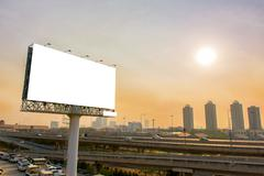 Billboard or advertising poster on highway for advertisement concept backgrou Stock Photos