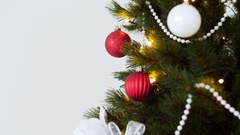 Christmas tree decorated with balls in sparkling lights Stock Footage