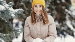 Happy young woman throws snow in air, slow motion. She enjoying winter. Stock Footage
