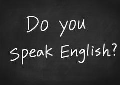 Do you speak English concept text on blackboard background Stock Illustration