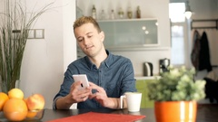 Red haired man answer cellphone and looking happy while talking Stock Footage