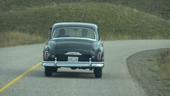 Drive plate concept, passenger POV following old car 1949 Desoto #2 Stock Footage