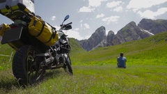 Traveler looking at the mountains. Resting, dreaming. Stock Footage