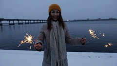 Woman with sparkler at winter rotating around outdoor, slow motion. Stock Footage