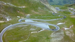 Road traffic on mountain pass summer. Aerial view. Stock Footage