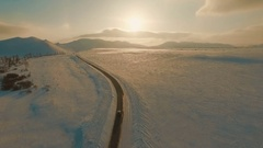 Several cars driving on icy road at the dusk Stock Footage