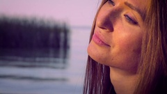 Light eyes freckles on her face, lovely smile Stock Footage