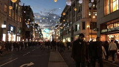 Christmas shoppers on Oxford Street in London, England at night. Stock Footage