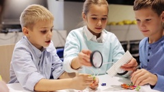 Happy children learning at robotics school Stock Footage