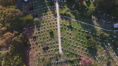 An aerial shot of a cemetary during the fall of 2016 - 4k Stock Footage