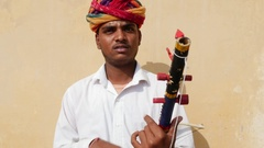 Musician playing traditional rajasthani music on the street of Jaipur Stock Footage