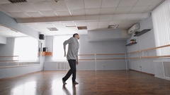 Hall for rehearsals. The dancer in convenient clothes rehearses. He works the Stock Footage