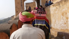 Men riding decorated elephants in Jaleb Chowk in Amber Fort, Jaipur, India Stock Footage