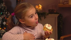 Little girl eating cinnamon rolls Stock Footage