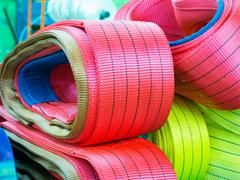 Colorful nylon soft lifting slings stacked in piles Stock Photos