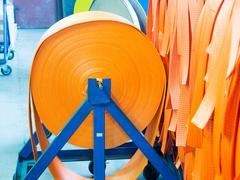 Orange soft nylon straps on roll Stock Photos