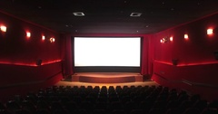 Cinema screen with open curtain and red seats / empty cinema hall Stock Footage