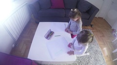 Two little girls drawing with crayons at home. Time lapse video  Stock Footage