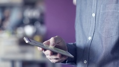 A man uses a touchscreen smartphone. Stock Footage