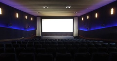 Empty cinema hall with blue seat cinema screen light glow Stock Footage