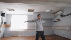 Man is dancing in dance studio. Dance movements rehearsal. Air conditioning in Stock Footage
