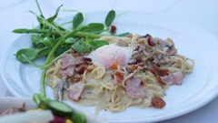 Italian pasta carbonara and tuna salad on table Stock Footage