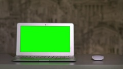 The laptop is on the table, lying next to the mouse the chromakey Stock Footage